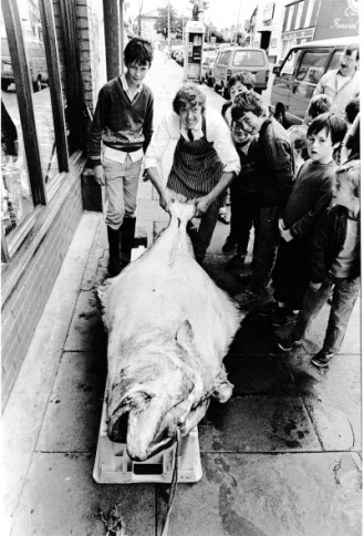Peter Caviston with a fantastic catch outside the shop in the 1970's